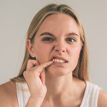 Woman with irritated gum tissue