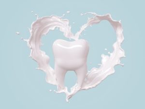 tooth with milk making the shape of a heart around it